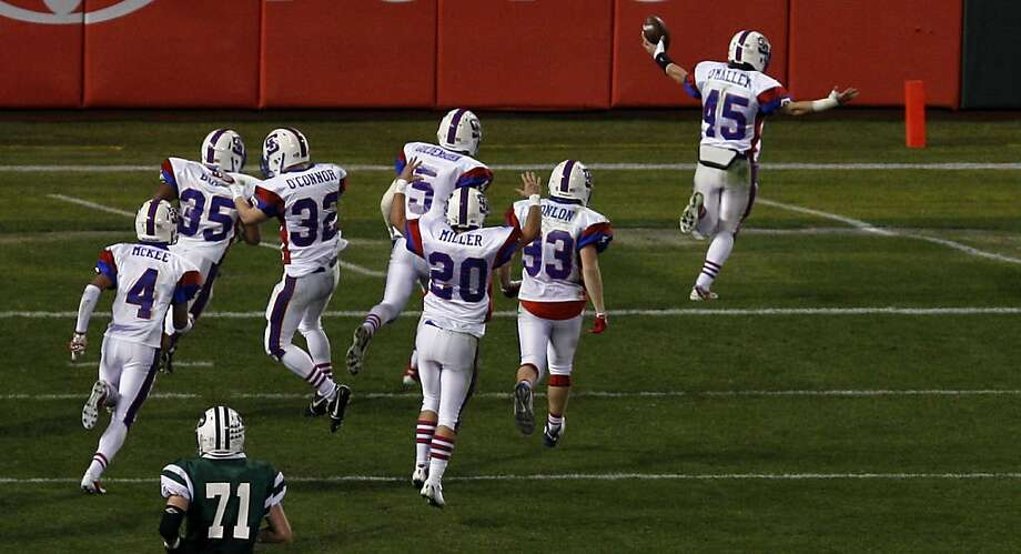 St. Ignatius Danny O'Malley (45) runs into the end zone for a touchdown during their game with Sacred Heart Cathedral Saturday December 3, 2011. O'Malley scooped up fumbled snap that turned out to be the winning score giving St. Ignatius the 21-14 victory at AT&T Park. Photo: Lance Iversen, The Chronicle
