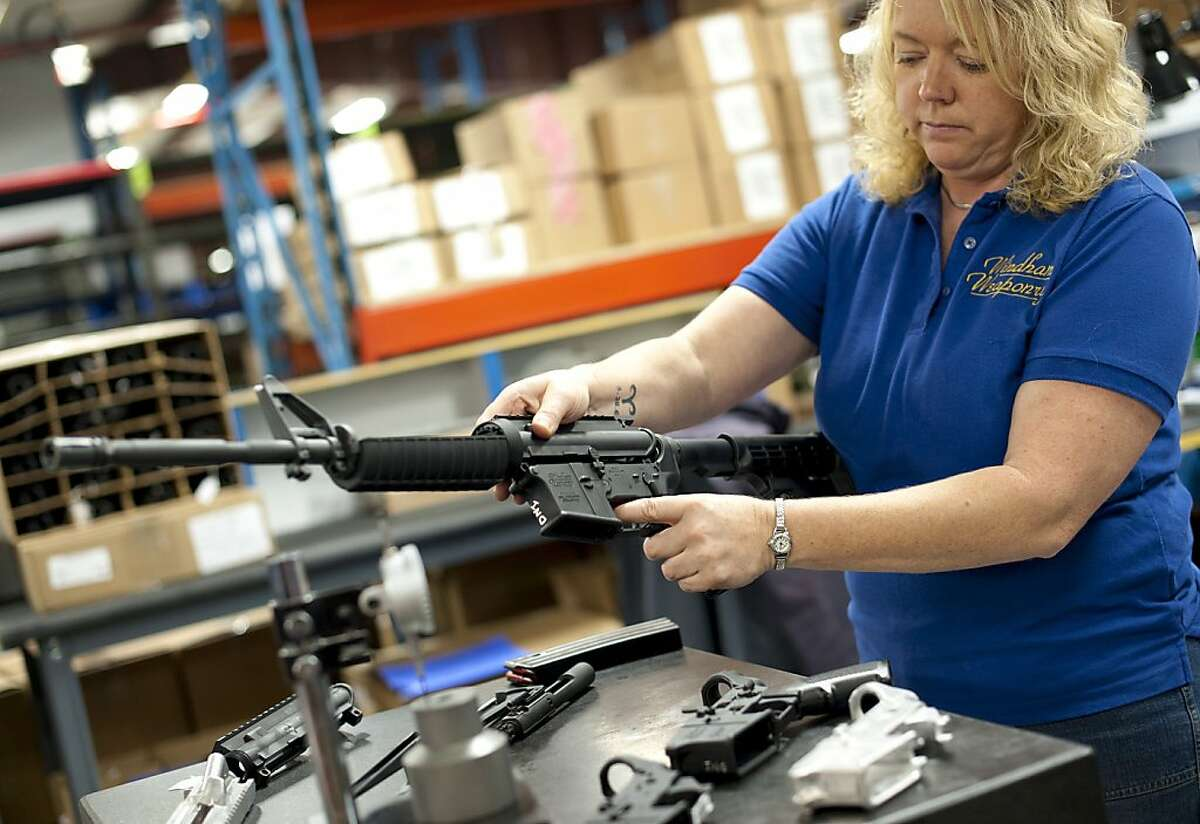 Tammy Hadley, a quality manager, inspects parts during the manufacturing of the AR-15 rifle at the Windham Weaponry Inc. factory in Windham, Maine, Oct. 27, 2011. In the last few years, many of the top names in rifles and shotguns have been acquired by the Freedom Group, a private company considered to be the most powerful force in the American commercial gun industry today. (Gretchen Ertl/The New York Times) -- PHOTOS MOVED IN ADVANCE AND NOT FOR USE - ONLINE OR IN PRINT - BEFORE NOV. 27, 2011. Ran on: 12-04-2011 Quality manager Tammy Hadley inspects parts of an AR-15 rifle at the Windham Weaponry Inc. factory in Maine.