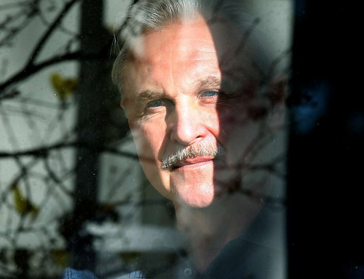 Monty Patterson peers out his living room window Tuesday November 29 2011. Patterson daughter Holly was the first woman in the United States to die from complications of taking the so-called abortion pill. Patterson, a former construction worker, has become something of a scientist and lobbyist, as he has worked relentlessly to raise awareness around the risks of the pill. He recently set up a website, www.abortionpillrisks.org.