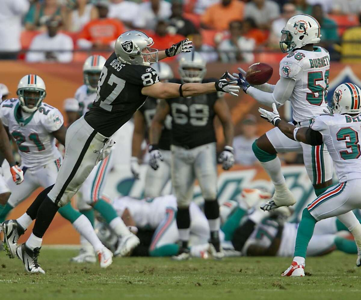 Oakland Raiders tight end Kevin Boss (87) can't catch this pass that Miami Dolphins Kevin Burnett intercepts and returns for a touchdown in the third quarter of the game at Sun Life Stadium, Sunday, December 4, 2011. (Joe Rimkus Jr./Miami Herald/MCT)