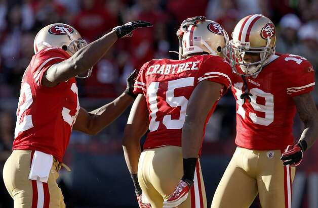 San Francisco 49ers Kendall Hunter, left  congratulates Michael Crabtree along with Ted Ginn Jr. after making a touchdown in the third quarter against the St. Louis Rams, Sunday Dec. 4, 2011, at Candlestick Park in San Francisco, Calif. Photo: Lacy Atkins, The Chronicle