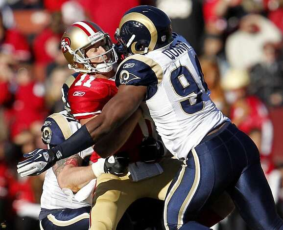 San Francisco 49ers quarterback Alex Smith  is sacked by St. Louis Rams Robert Quinn  in the second half against,  Sunday Dec. 4, 2011, at Candlestick Park in San Francisco, Calif. Photo: Lacy Atkins, The Chronicle