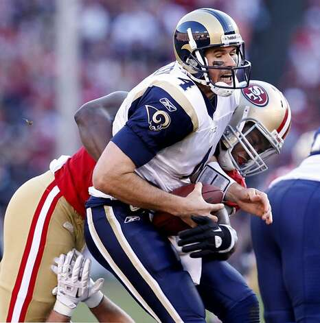 St. Louis Rams quarterback Donnie Jones is sacked by San Francisco 49ers Aldon Smith in the second half,  Sunday Dec. 4, 2011, at Candlestick Park in San Francisco, Calif. Photo: Lacy Atkins, The Chronicle