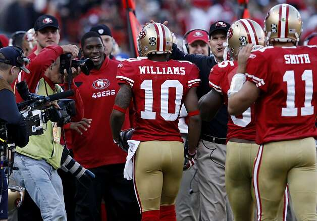 San Francisco 49ers Kyle Williams  is congratulates by team and head coach Jim Harbaugh tries the break loss of St. Louis Rams Chris Chamberlain in the second half,  Sunday Dec. 4, 2011, at Candlestick Park in San Francisco, Calif. Photo: Lacy Atkins, The Chronicle