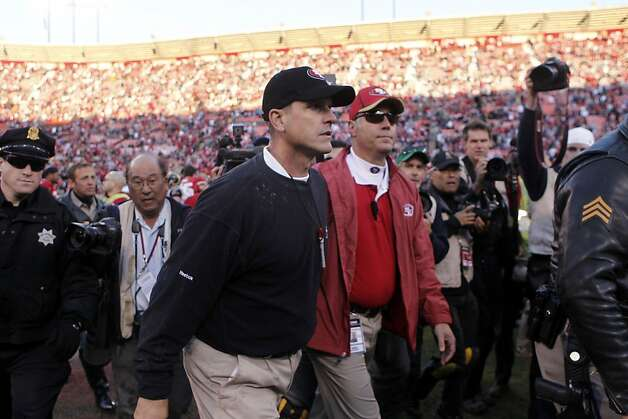 San Francisco 49ers head coach Jim Harbaugh walks off the field after the 49ers defeated the Rams 26-0, Sunday Dec. 4, 2011, at Candlestick Park in San Francisco, Calif. Photo: Lacy Atkins, The Chronicle