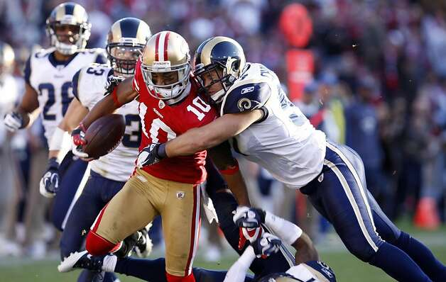 San Francisco 49ers Kyle Williams  tries the break loss of St. Louis Rams Chris Chamberlain in the second half,  Sunday Dec. 4, 2011, at Candlestick Park in San Francisco, Calif. Photo: Lacy Atkins, The Chronicle