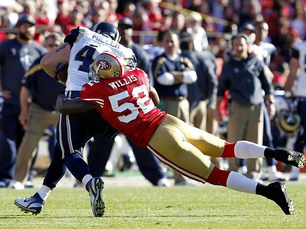 San Francisco 49ers Patrick Willis tackles St. Louis Rams Brit Miller in the first quarter,  Sunday Dec. 4, 2011, 26-0, at Candlestick Park in San Francisco, Calif. Willis was hurt in the play with a hamstring inquiry and this out the rest of the game. Photo: Lacy Atkins, The Chronicle