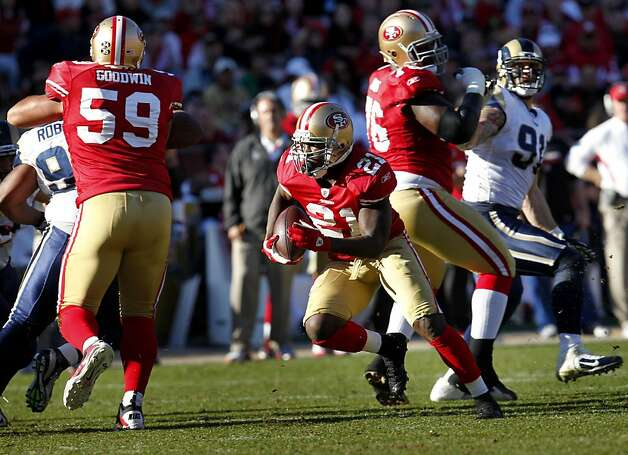 San Francisco 49ers Frank Gore runs to make a first down against the St. Louis Rams, Sunday Dec. 4, 2011, at Candlestick Park in San Francisco, Calif. Gore broke the team rushing recorded. Photo: Lacy Atkins, The Chronicle