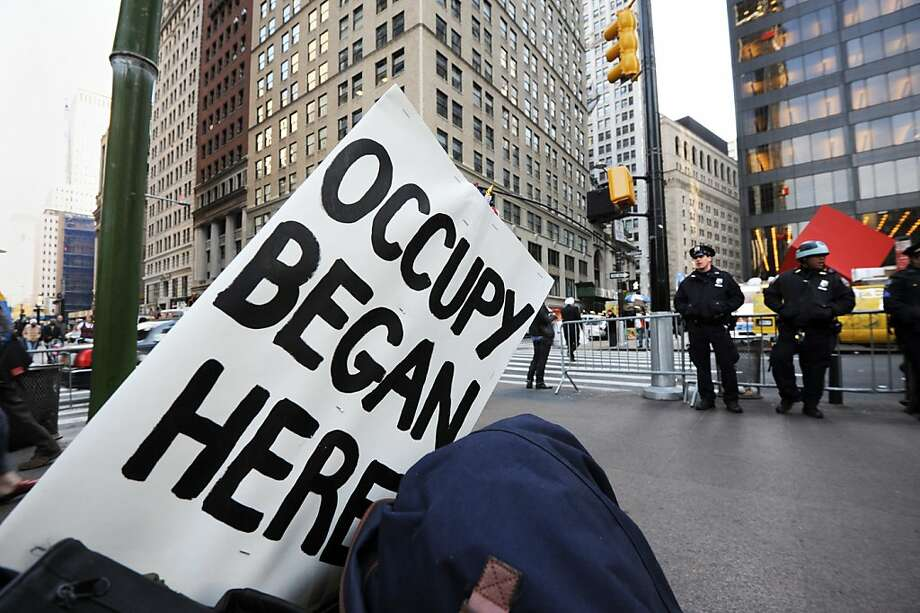 Demonstrators with 'Occupy Wall Street' continue their protest at Zuccotti Park November 14, 2011 in New York. The demonstrators are protesting bank bailouts, foreclosures and high unemployment from their encampment in the financial district of New York City. AFP PHOTO/Stan HONDA (Photo credit should read STAN HONDA/AFP/Getty Images) Photo: Stan Honda, AFP/Getty Images