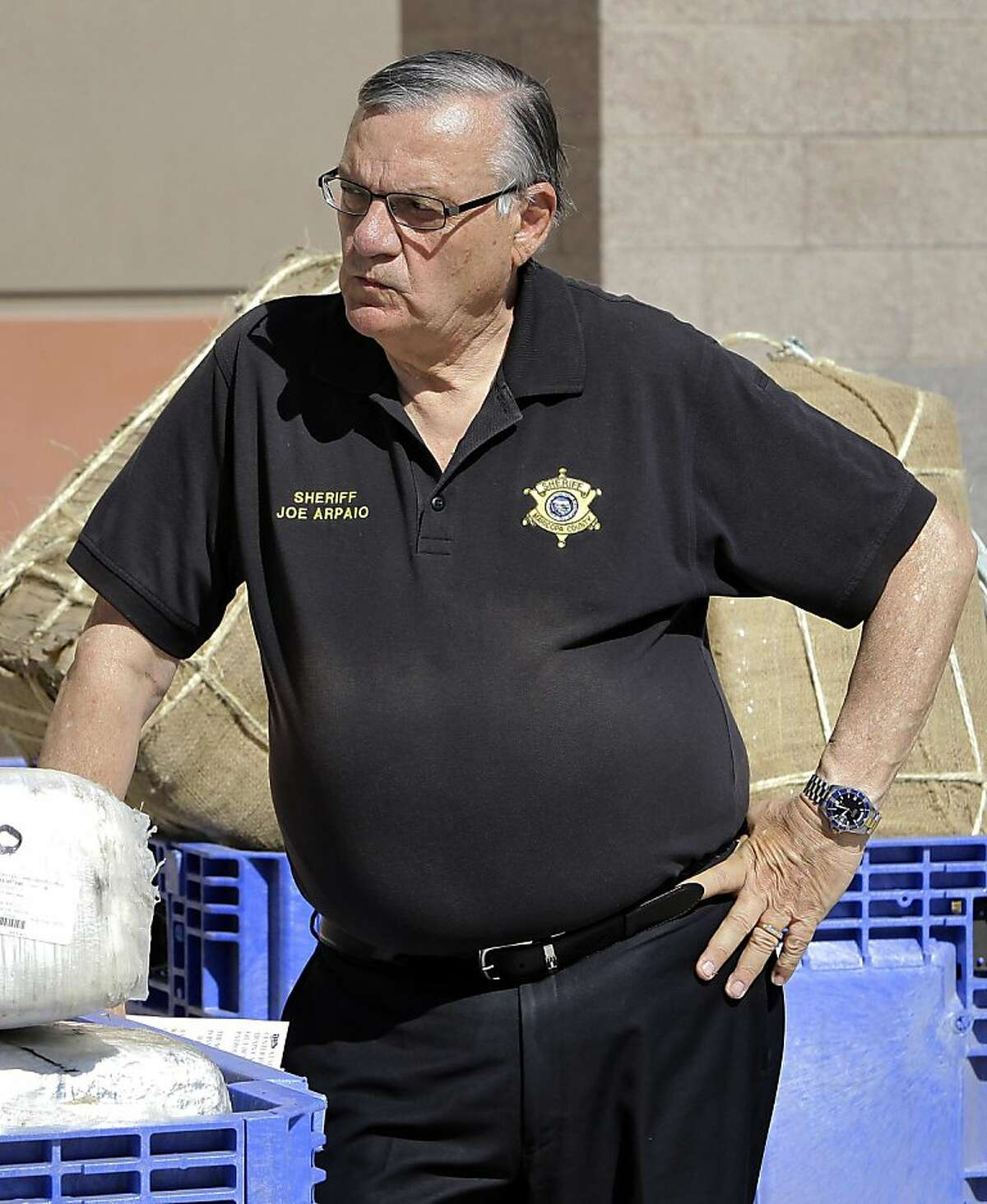 FILE - In this May 12, 2011 file photo, Maricopa County Sheriff Joe Arpaio, showcasing 2,300 lbs of seized marijuana, waits to address the media outside the Sheriff's training center in Phoenix. More than 400 sex-crimes reported to Arpaio's office during a three-year period ending in 2007, including dozens of alleged child molestations, were inadequately investigated and in some instances were not worked at all, according to current and former police officers familiar with the cases. (AP Photo/Matt York, File) Ran on: 12-05-2011 Photo caption Dummy text goes here. Dummy text goes here. Dummy text goes here. Dummy text goes here. Dummy text goes here. Dummy text goes here. Dummy text goes here. Dummy text goes here.###Photo: sheriff05_ph21305072000AP###Live Caption:FILE - In this May 12, 2011 file photo, Maricopa County Sheriff Joe Arpaio, showcasing 2,300 lbs of seized marijuana, waits to address the media outside the Sheriff's training center in Phoenix. More than 400 sex-crimes reported to Arpaio's office during a three-year period ending in 2007, including dozens of alleged child molestations, were inadequately investigated and in some instances were not worked at all, according to current and former police officers familiar with the cases.###Caption History:FILE - In this May 12, 2011 file photo, Maricopa County Sheriff Joe Arpaio, showcasing 2,300 lbs of seized marijuana, waits to address the media outside the Sheriff's training center in Phoenix. More than 400 sex-crimes reported to Arpaio's office during a three-year period ending in 2007, including dozens of alleged child molestations, were inadequately investigated and in some instances were not worked at all, according to current...