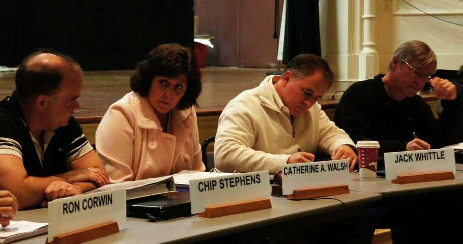 The Planning and Zoning Commission's four newly-elected Republican members deliberate during a meeting on Thursday, Dec. 1, 2011. From left, are: Chip Stephens, Catherine Walsh, Jack Whittle and Al Gratrix. Photo: Paul Schott / Westport News