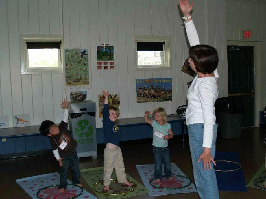 Tae Bazata, Teddy Grogan, Emma Grzymski and Mary Moran practice yoga. Photo: Contributed Photo