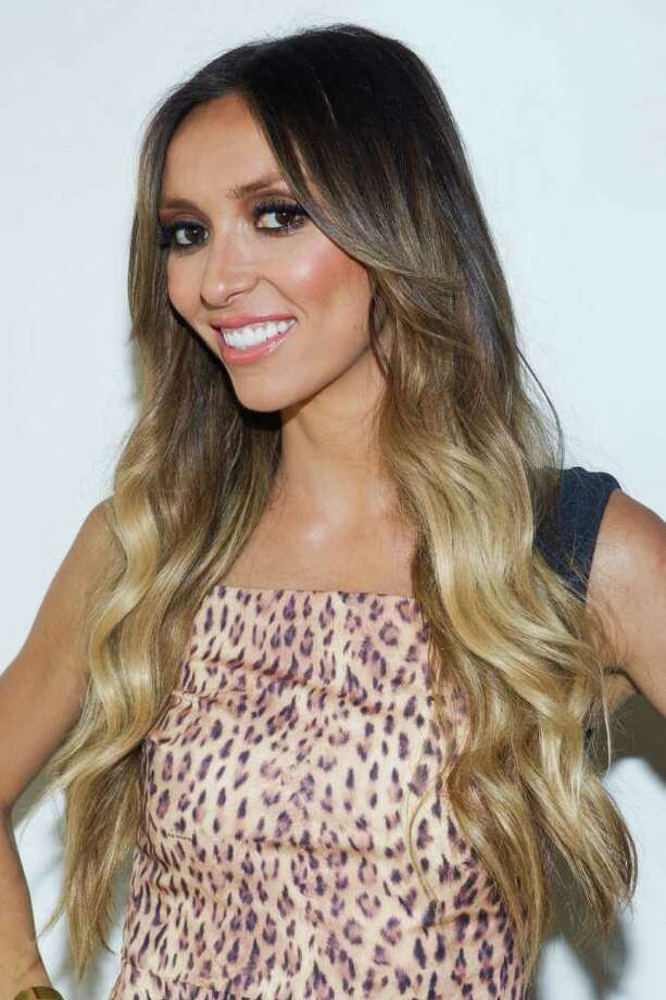 "FILE - In this Sept. 12, 2011 file photo, TV personality Giuliana Rancic attends the Rachel Zoe Spring 2012 fashion show during Mercedes-Benz Fashion Week in New York. Six weeks after revealing that she has breast cancer, E! News host Giuliana Rancic, 37, announced Monday, Dec. 5, 2011, on NBC's ""Today"" show that she will have a double mastectomy.  (AP Photo/Charles Sykes, file) Photo: Charles Sykes"