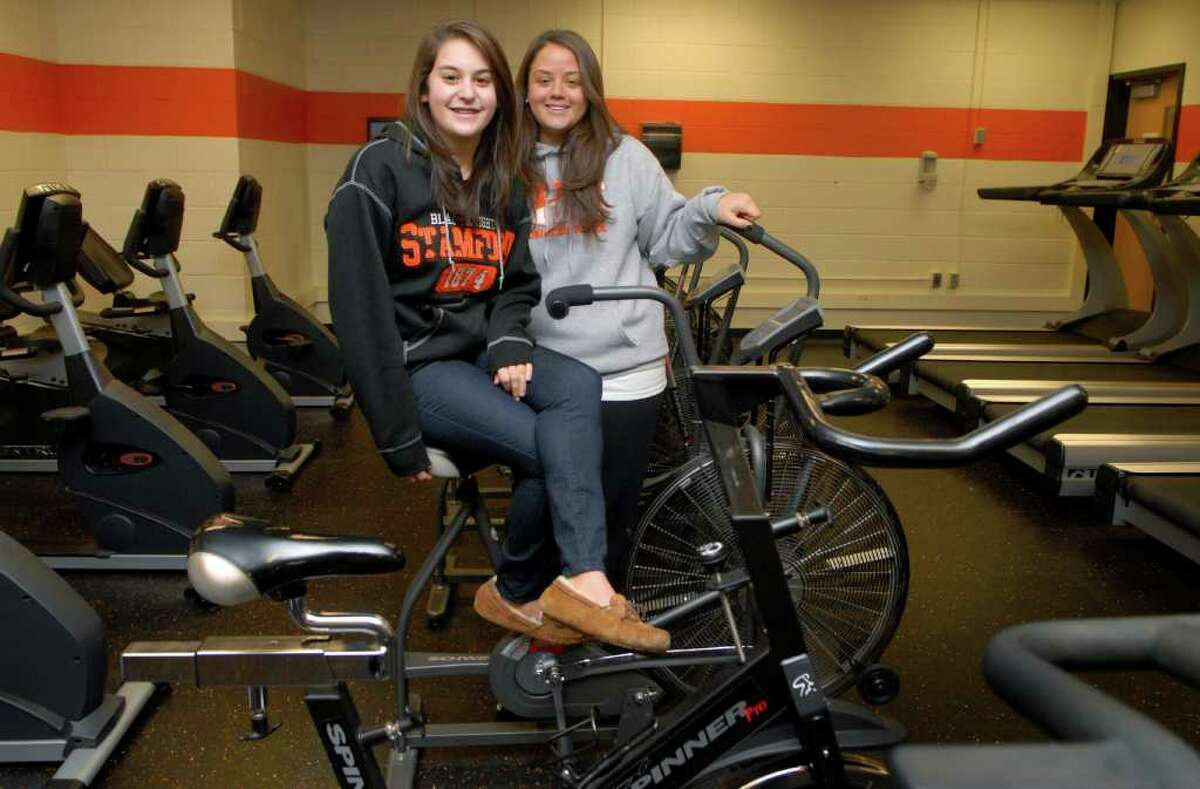 Sam Pesiri, a 15 year old Stamford High School student, lost 70 pounds in the last year, bringing her down from almost 200 pounds, to a healthier 130. She did it with the help of her health teacher Jenna Bartolo and the school's cardio club. Sam and Jenna are photographed at the cardio club at Stamford High School in Stamford, Conn. on Friday December 2, 2011.