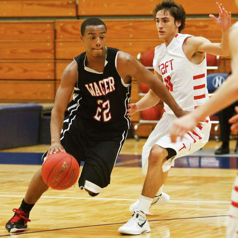 Avionte Sanders (left), shown against Taft's Justin Guerra, and Wagner have lost just two games this season. Photo: Marvin Pfeiffer/Prime Time Newspapers / Prime Time Newspapers 2011