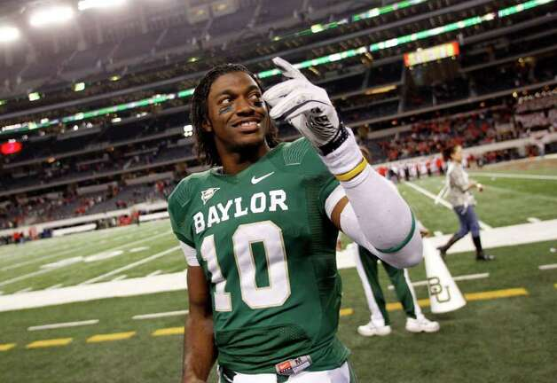 Baylor quarterback Robert Griffin III (10) waves to the crowd following an NCAA college football game against Texas Tech, Saturday, Nov. 26, 2011, in Arlington, Texas. Baylor won 66-42. Photo: AP