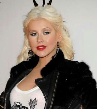 """Singer Christina Aguilera arrives at the launch party for the video game """"The Elder Srolls V: Skyrim"""" in Los Angeles on Tuesday, Nov. 8, 2011. Photo: AP"""