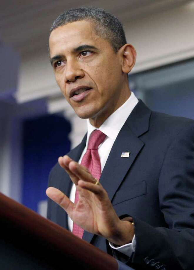 President Barack Obama makes a statement to reporters in the James Brady Press Briefing Room at the White House in Washington, Monday, Dec. 5, 2011, urging Republican lawmakers to pass the payroll tax cut. (AP Photo/Charles Dharapak) Photo: Charles Dharapak / AP