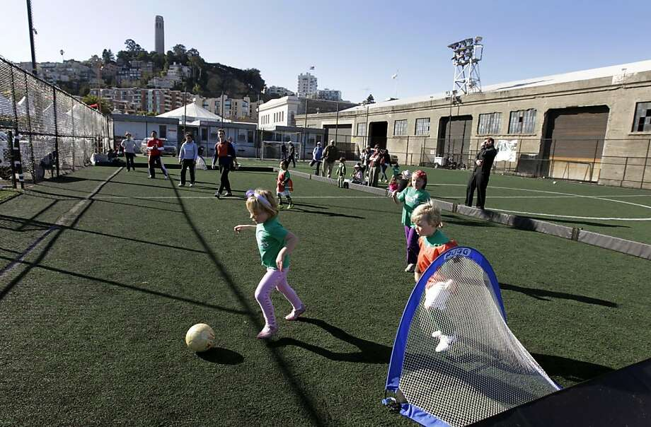 Children participate in the Soccer Tots program on the field behind Pier 27 in San Francisco, Calif. on Saturday, Dec. 3, 2011. The recreational field is one of many entities along the waterfront that are forced to close or relocate to make room for the America's Cup competition in 2013. Photo: Paul Chinn, The Chronicle