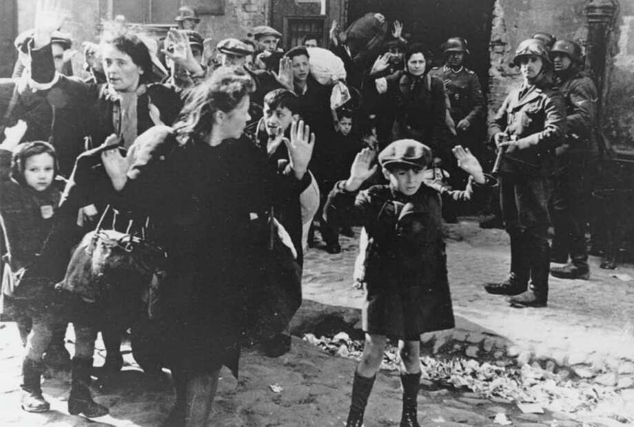 FILE- In this April 19, 1943 file photo, a group of Jews areescorted from the Warsaw Ghetto by German soldiers. After a year of tough negotiations, Germany agreed Monday, Dec. 5, 2011, to pay pensions to about 16,000 Holocaust victims worldwide who survived wartime ghettos or were forced to hide from Nazi persecution. (AP Photo, File) Photo: Anonymous
