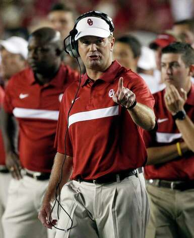Oklahoma coach Bob Stoops will faced his alma mater, Iowa, for the first time in the Insight Bowl. Photo: Chris O'Meara, Associated Press