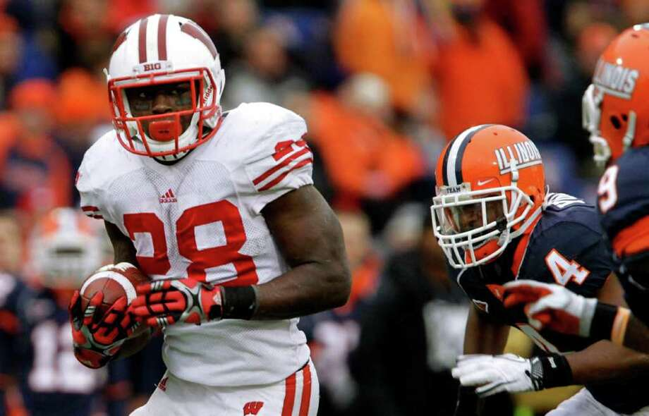 Wisconsin running back Montee Ball (28) runs with the ball away from the Illinois defense during the second half of the NCAA college football game Saturday, Nov. 19, 2011 in Champaign, Ill. Wisconsin defeated Illinois 28-17. Photo: AP