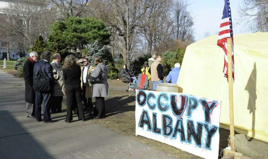 A group of attorneys gather for a meeting with city officials on the subject of the Occupy Albany encampment in Albany, N.Y. Dec. 5, 2011.   (Skip Dickstein/Times Union) Photo: Skip Dickstein / 10015665A