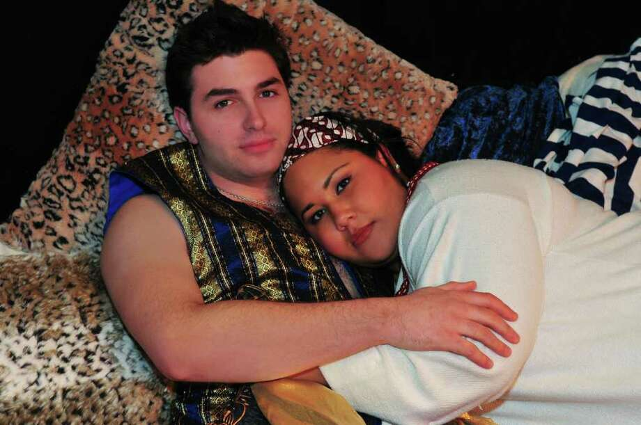 Nick Abounader, as Radames, an Egyptian General and Dashira Cortes, as Aida, a Nubian Princess, fall in love in SLOC?s production of Elton John?s Aida.  (Photos by Shawn Morgan Photography)