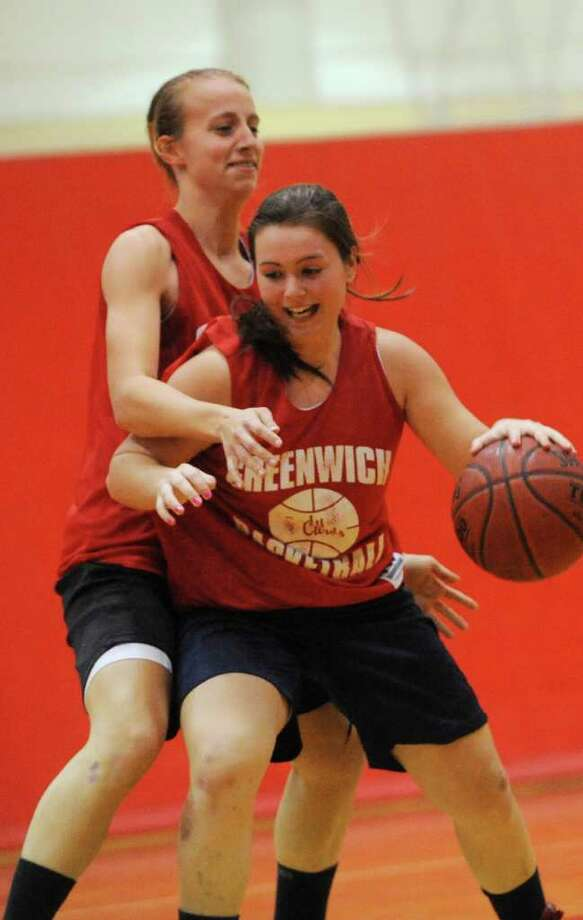 Amanda Onofrio, co-captain, left, with Erica Ambrogio in a practice at Greenwich High girls basketball Monday, Dec. 5, 2011. Photo: Helen Neafsey / Greenwich Time