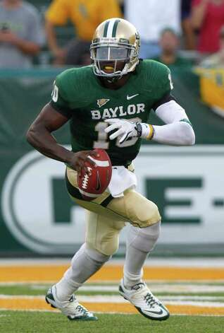 Baylor quarterback Robert Griffin III (10) looks to pass during the first half of the NCAA college football game against TCU in Waco, Texas, Friday, Sept. 2, 2011. Photo: AP