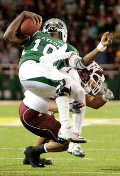 Texas A&M cornerback Trent Hunter (1) makes a hard tackle on Baylor quarterback Robert Griffin III (10) that forced the quarterback out of the game for one play in the third quarter of an NCAA Big XII Conference football game between Baylor and Texas A&M at Floyd Casey Stadium on Saturday, Nov. 13, 2010, in Waco. Photo: Julio Cortez, Houston Chronicle / © 2010 Houston Chronicle