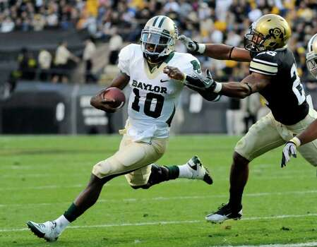 Baylor  quarterback Robert Griffin III (10) runs against Colorado safety Ray Polk (26) during the first half of an NCAA college football game Saturday, Oct. 16, 2010, in Boulder, Colo. Photo: AP