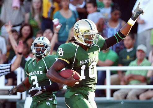 "FILE - In this Sept. 4, 2010, file photo, Baylor quarterback Robert Griffin (10) scores a first quarter touchdown against Sam Houston State during an NCAA college football game in Waco, Texas. They have heard the derisive chants of ""Worse than Baylor!"" Now the Baylor Bears point to the top of the Big 12 South standings, where they sit alone in first place. Photo: AP"