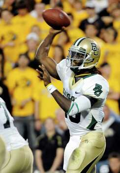 Baylor  quarterback Robert Griffin III (10) throws against Colorado during the first half of an NCAA college football game Saturday, Oct. 16, 2010, in Boulder, Colo. Photo: AP