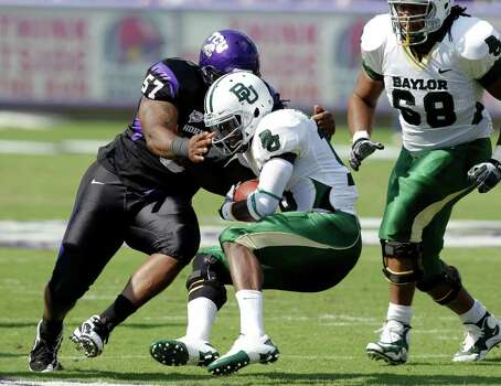 TCU defensive tackle Cory Grant (57) sacks Baylor quarterback Robert Griffin III, front, as offensive tackle Cyril Richardson (68) looks on in the first half of an NCAA football game Saturday, Sept. 18, 2010, in Fort Worth, Texas. Photo: AP