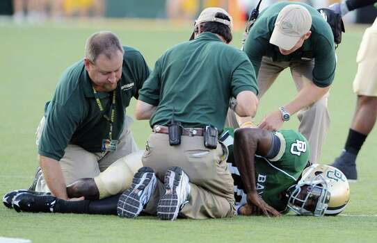Baylor sophomore quarterback Robert Griffin  is examined after sustaining a torn ACL in his right knee during an NCAA college football game against Northwestern State on Saturday Sept. 26, 2009 in Waco Texas. Griffin is out for the year. Photo: Rod Aydelotte, AP / Waco Tribune Herald
