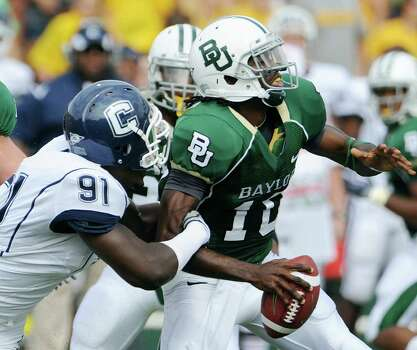 Connecuticut  Jesse Joseph (91) tackles Baylor quarterback Robert Griffin (10) for a loss in the first quarter of a NCAA  college football game Saturday, Sept. 19, 2009, in Waco Texas. Photo: Rod Aydelotte, AP / Waco Tribune Herald