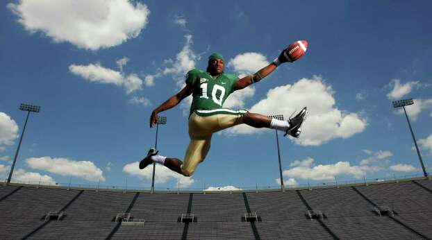 Baylor's quarterback Robert Griffin soars for a portrait, May 21, 2009, at Floyd Casey Stadium in Waco. Photo: EDWARD A. ORNELAS, SAN ANTONIO EXPRESS-NEWS / eaornelas@express-news.net