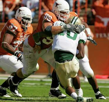 AUSTIN, TX - NOVEMBER 8:  Defensive tackle Roy Miller #99 of the Texas Longhorns sacks quarterback Robert Griffin #10 of the Baylor Bears in the second quarter on November 8, 2008 at Darrell K Royal-Texas Memorial Stadium in Austin, Texas.  (Photo by Brian Bahr/Getty Images) *** Local Caption *** Roy Miller;Robert Griffin Photo: Brian Bahr, Getty Images / 2008 Getty Images