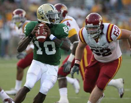 Baylor quarterback Robert Griffin, left, looks down field while being pressured by Iowa State's Nate Frere, right the third quarter of a college football game Saturday, Oct. 11, 2008 in Waco Texas. Photo: Duane A. Laverty, AP / Waco Tribune Herald