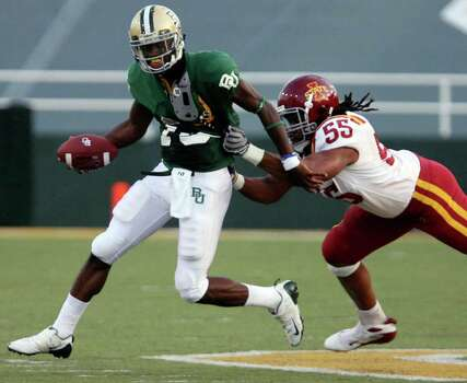 Baylor quarterback Robert Griffin is chased by Iowa State defender Christopher Lyle in an NCAA college football game, Saturday, Oct. 11, 2008 in Waco, Texas. Photo: Duane A. Laverty, AP / Waco Tribune Herald