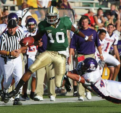 Baylor quarterback Robert Griffin (10) leaps past Northwestern State's Blake Delcambre, right, during first quater action of an NCAA college football game Saturday Sept. 6, 2008 in Waco, Texas. Photo: Jerry Larson, AP / Waco Tribune Herald