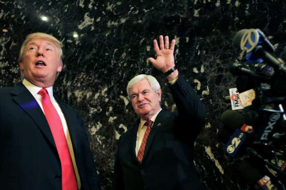 Republican presidential candidate, former House Speaker Newt Gingrich, right, waves after meeting with Donald Trump, and talking to the media in New York, Monday, Dec. 5, 2011.  (AP Photo/Seth Wenig) Photo: Seth Wenig