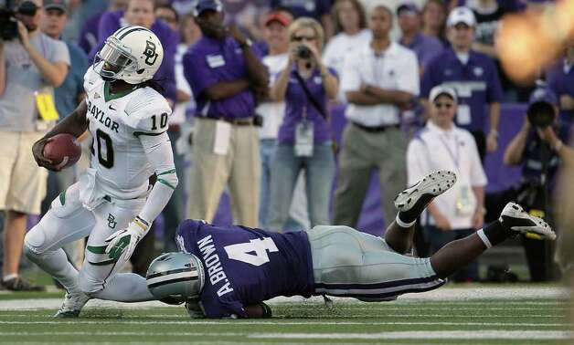 Baylor quarterback Robert Griffin III (10) is tackled by Kansas State linebacker Arthur Brown (4) during the fourth quarter of an NCAA college football game Saturday, Oct. 1, 2011, in Manhattan, Kan. Kansas State won 36-35. Photo: AP