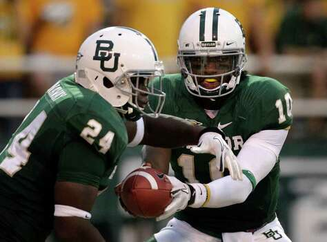 Baylor quarterback Robert Griffin III (10) hands off to running back Terrance Ganaway (24) in the first half of an NCAA college football game against Stephen F. Austin, Saturday, Sept. 17, 2011, in Waco, Texas. Photo: AP