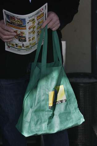 A Safeway reusable bag is seen being used by a shopper on Monday, January 24, 2011 in San Francisco. Photo: Lea Suzuki, The Chronicle
