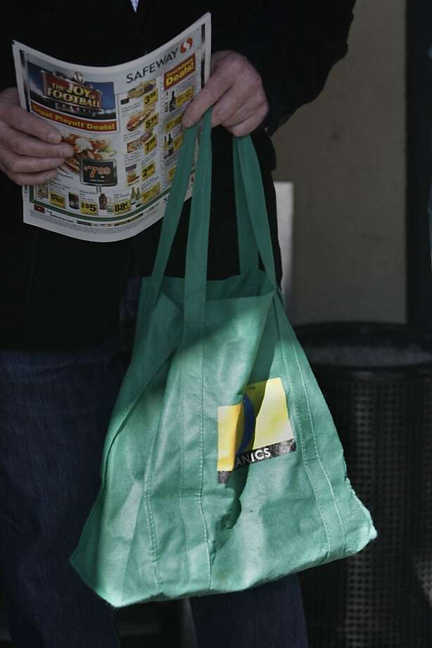 A Safeway reusable bag is seen being used by a shopper on Monday, January 24, 2011 in San Francisco, Calif. Photo: Lea Suzuki, The Chronicle