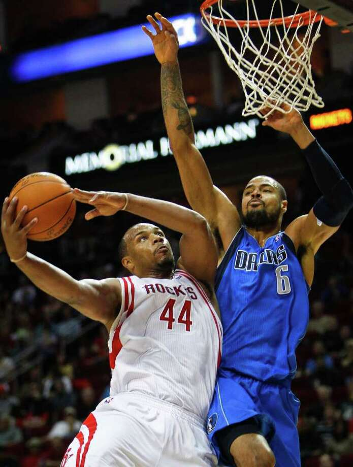 Talks with Chuck Hayes (left), the Rockets' lone free agent, are on hold while the team tries to lure Tyson Chandler (right) or Nene to town. Photo: Michael Paulsen, Chronicle / Houston Chronicle