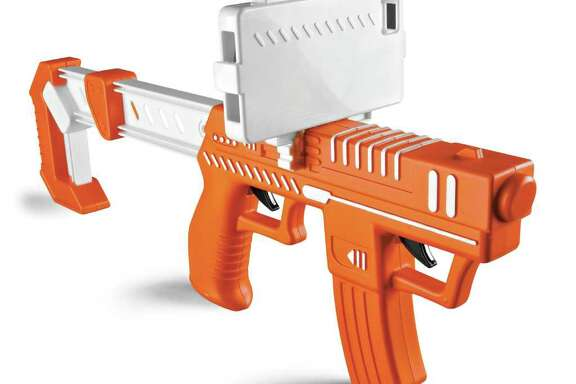 This product photo provided by Spin Master Ltd, shows the Appblaster, a plastic gun slipped onto an iPhone or iPod Touch so kids can shoot at aliens that pop up on the screen. (AP Photo/Spin Master Ltd, Tom Szuba)