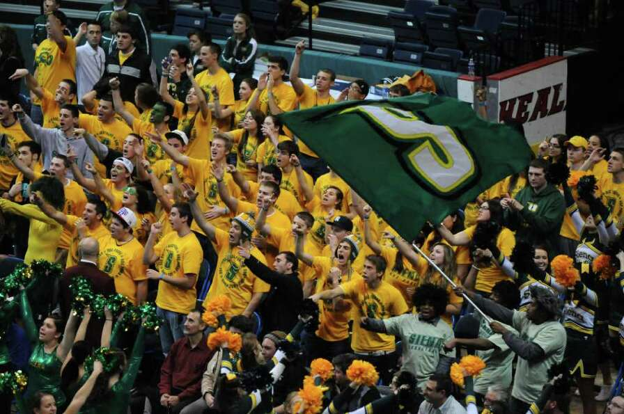 Siena fans celebrate during the second half of their team's 64-60 win over UAlbany at the Times Unio